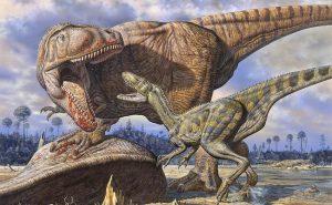 dinosaurios peleando por comida